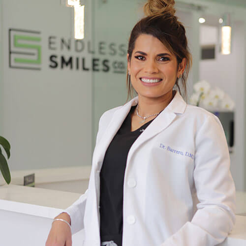 Dr. Odelsis Barrero smiling in front of the entrance reception in Endless Smile