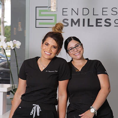 Assistant and doctor smiling together