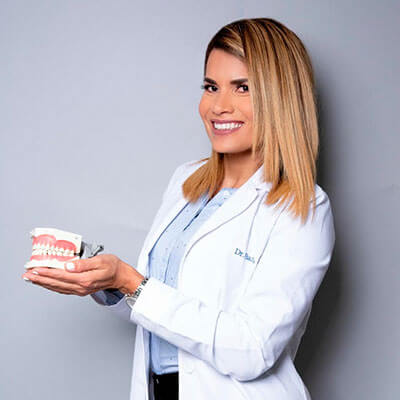 Doctor holding up tooth model